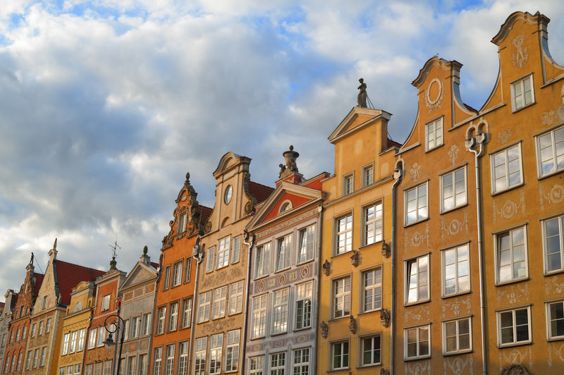 historical houses in Gdansk Poland Architecture Building Building Exterior Built Structure City City Life Cloud Cloud - Sky Cloudy Colors Day Exterior Façade Gansk Historical Low Angle View No People Outdoors Poland Residential Building Sky Travel Destinations