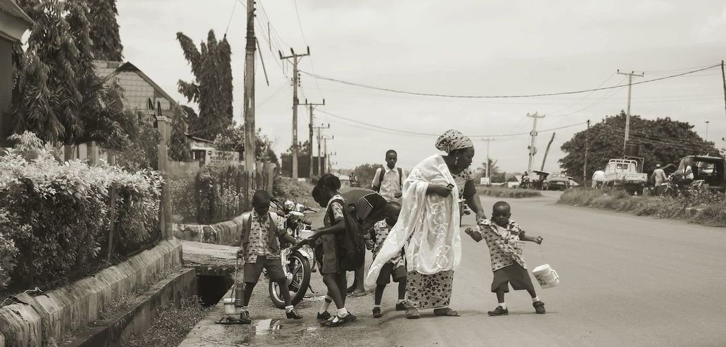 Mother with children on street