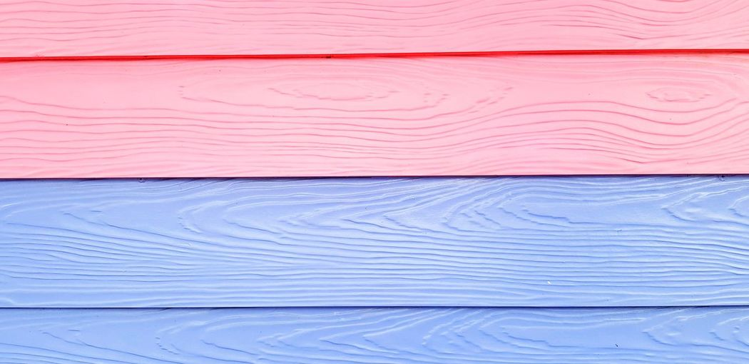 Full frame shot of pink and blue wooden table