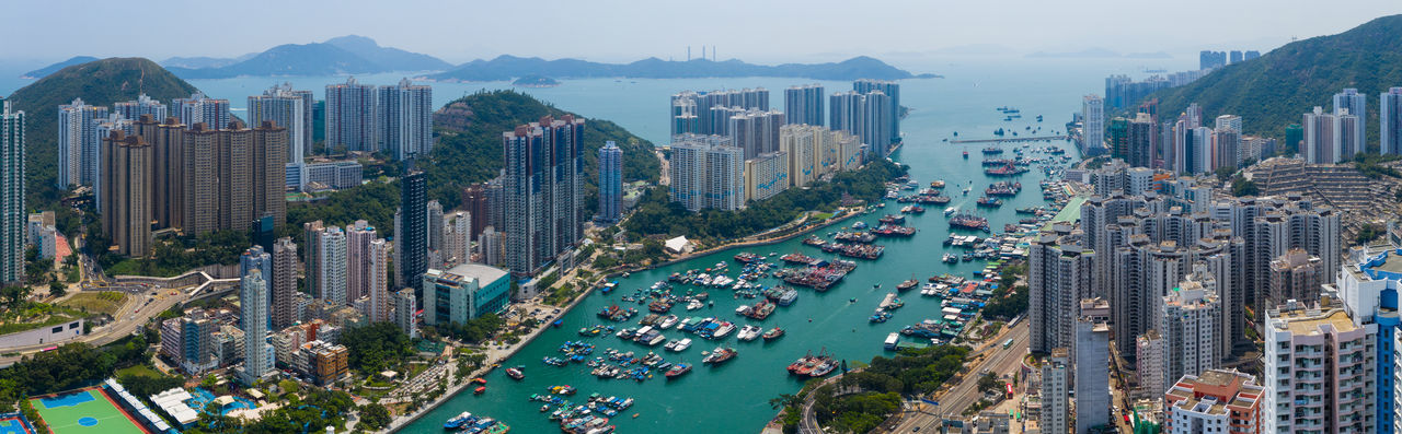 Top down view of Hong Kong downtown city Hong Kong Top View Building Aberdeen Harbor Port Fish Boat Ship Sea Seascape Ocean Bay Water Typhoon Shelter Ap Lei Chau State Street Urban Sky Architecture Town Office Road ASIA Cityscape Skyline Skyscraper Downtown Aerial Fly Drone  Over Above Down Top Down Bird Eye Hk Hong Kong City