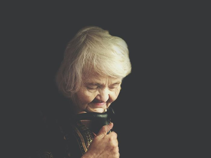 Sadness Sad Black Background Senior Adult One Person Headshot Blond Hair Holding People One Senior Woman Only Studio Shot Adult Indoors  One Woman Only Only Women