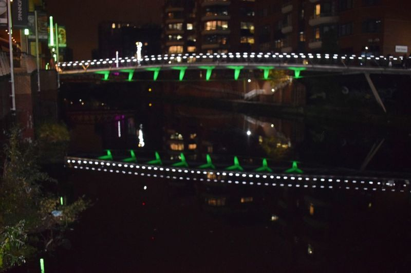 Illuminated lights in city at night