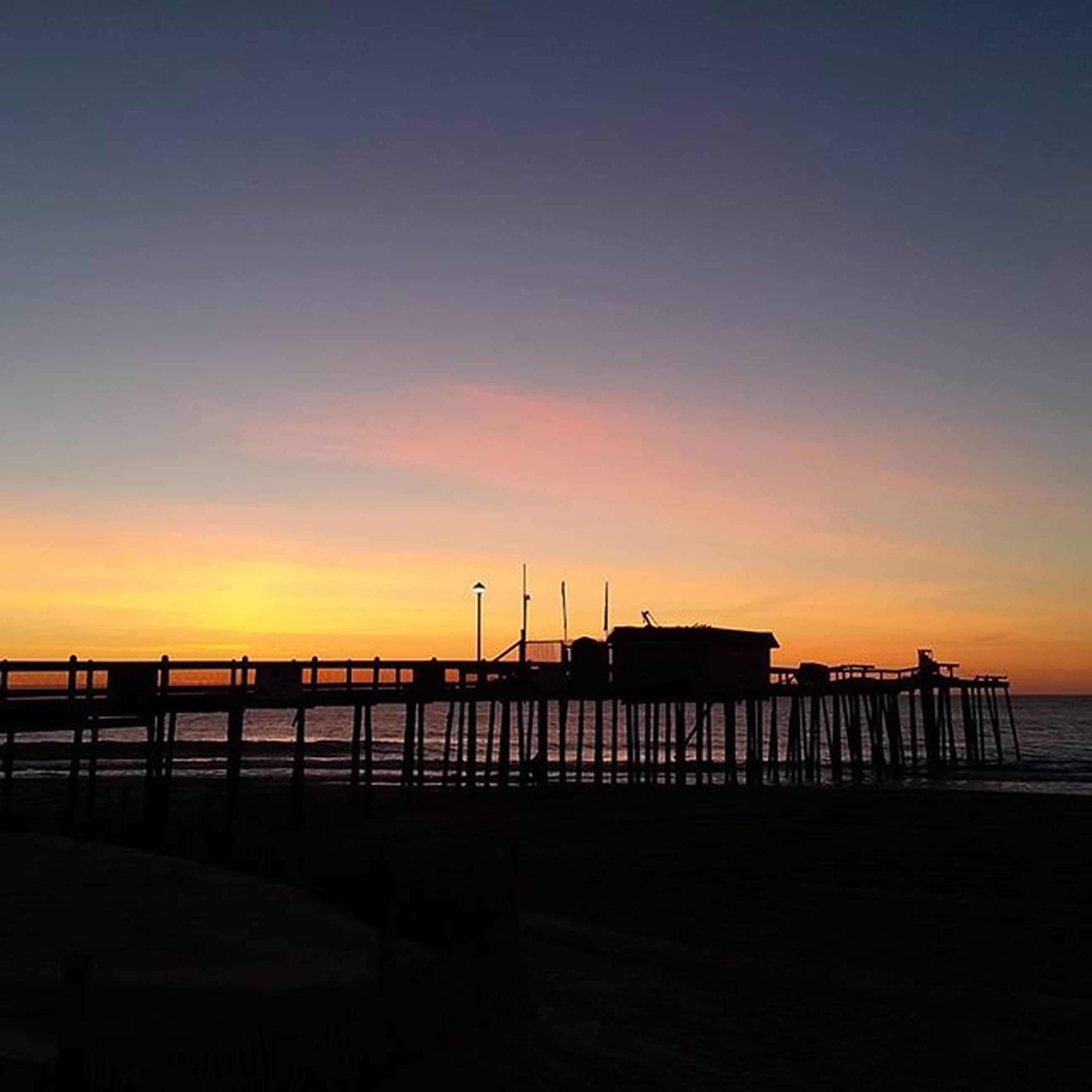 sunset, sea, water, orange color, silhouette, pier, built structure, sky, copy space, architecture, scenics, tranquility, beauty in nature, tranquil scene, dusk, transportation, nature, nautical vessel, horizon over water, beach