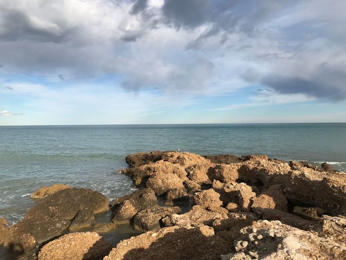 Sea Horizon Over Water Sky Water Nature Cloud - Sky Rock - Object Tranquil Scene Beauty In Nature No People Beach Outdoors