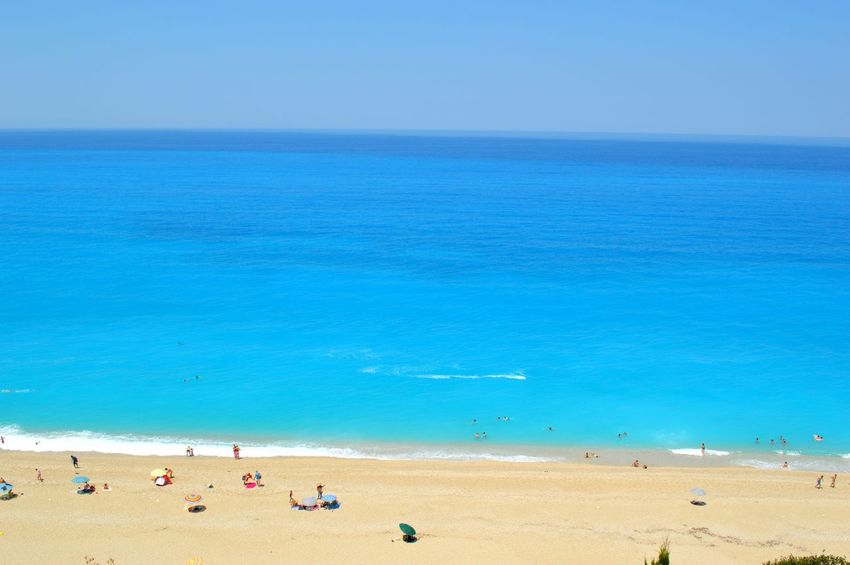 Milos beach in Lefkada Beach Beauty In Nature Blue Coastline Day Enjoyment Horizon Over Water Idyllic Leisure Activity Showcase July Mixed Age Range Nature Outdoors Relaxation Scenics Sea Shore Sky Summer Tourism Tourist Tranquil Scene Tranquility Vacations Water