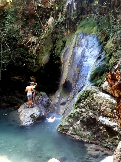 Kythera island! 👉mylopotamos👈 Water Full Length Beauty Women Waterfall Adventure Sitting Beautiful Woman River Rock - Object First Eyeem Photo