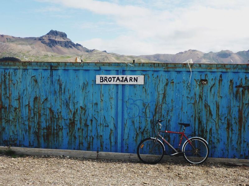 Bicycle parking Bicycle Parking Recycling Container Island Iceland Eastfjords Borgarfjörður Eystri Bakkagerði Mountain Text Sky Outdoors Day No People Bicycle