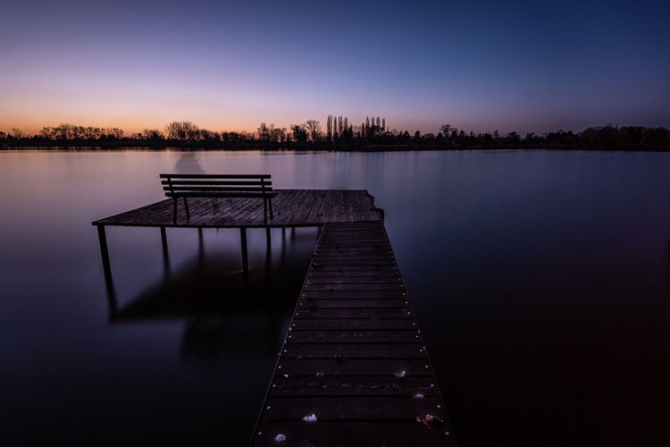 Copy Space Reflection Water Sunset Nature Sky Dusk Tree Sundown Jetty Pier Outdoors Tranquility Long Exposure Beauty In Nature No People Idyllic Orange Color Tranquil Scene Non-urban Scene Wood - Material Scenics - Nature Remote Lake