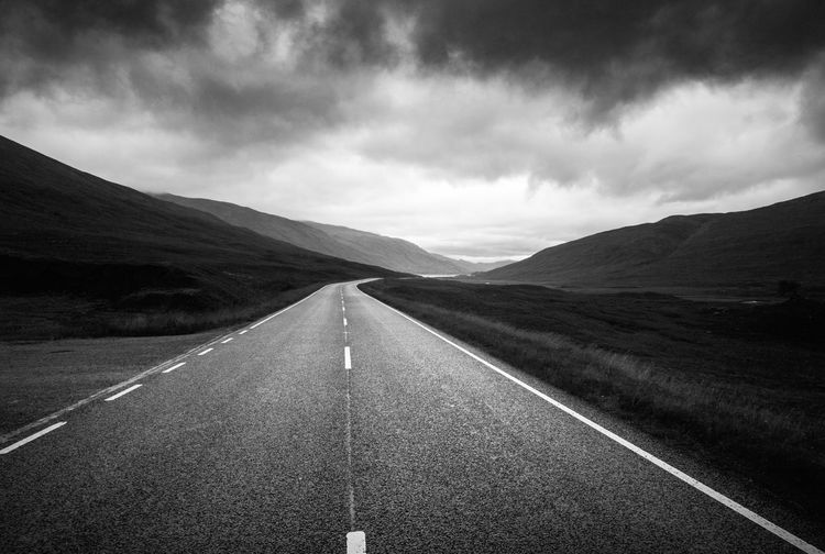 Isle of Skye. August 2016 Blackandwhite Cloud - Sky Diminishing Perspective Dividing Line Dramatic Sky High Contrast Isle Of Skye Landscape Long Mountain Mountain Range Nature Non-urban Scene Outdoors Remote Road Road Marking Scenics Scotland Solitude Surface Level The Way Forward Tranquil Scene Tranquility White Line