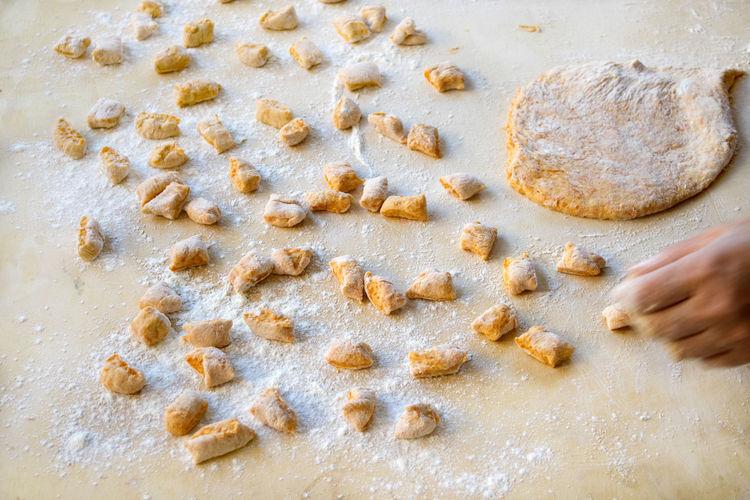 preparing gnocchi pasta Dough Flour Gnocchi Homemade Pasta Preparing Raw Rolling Pin