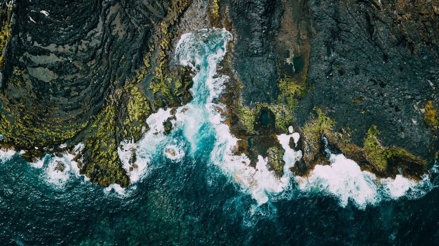 Aerial View Of Waves Rushing At Beach
