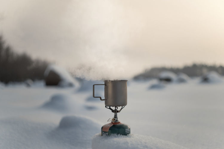 Boiling tea in a titanium mug on a gas Winter time Finland Gas Hiking Russia Barnerd Beauty In Nature Boiling Close-up Cold Temperature Day Drink Environment Field Frozen Ice Landscape Mug Nature No People Outdoors Scenics - Nature Snow Teatime Titanium Winter