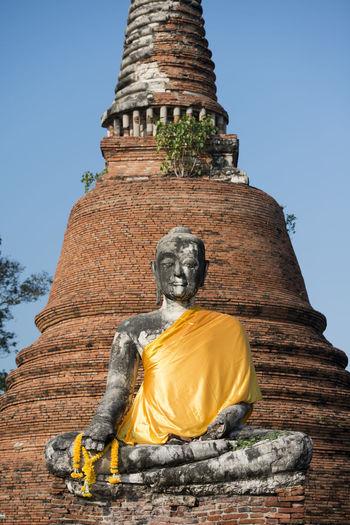 Low Angle View Of Buddha Statue At Wat Mahathat