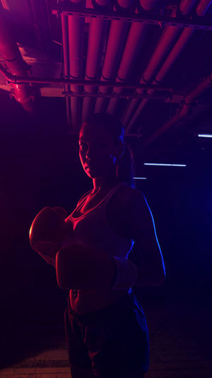 Midsection of woman standing in illuminated stage