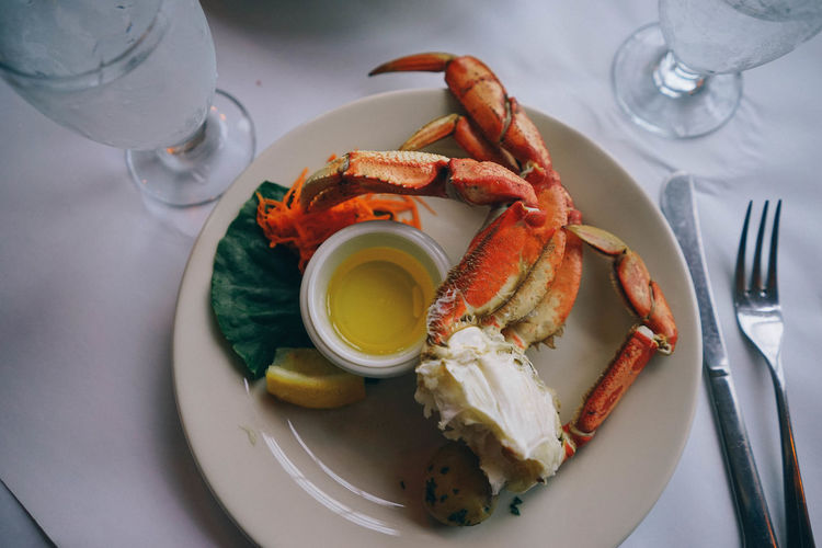 Crab Dish Food And Drink Food Plate Table Freshness High Angle View Indoors  Ready-to-eat Drink Seafood Eating Utensil Healthy Eating Kitchen Utensil Meal Household Equipment Fork Wellbeing Refreshment Restaurant Serving Size Glass No People Table Knife Crab - Seafood