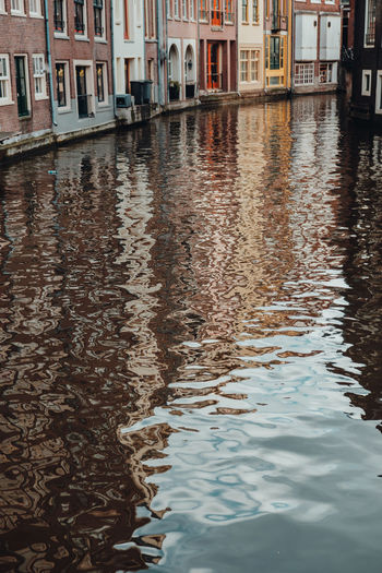 Waters of Amsterdam canal reflecting buildings Architecture_collection Holland Netherlands Amsterdam Water Reflections Amsterdam Canal Water City Street Cityscape Urbanphotography