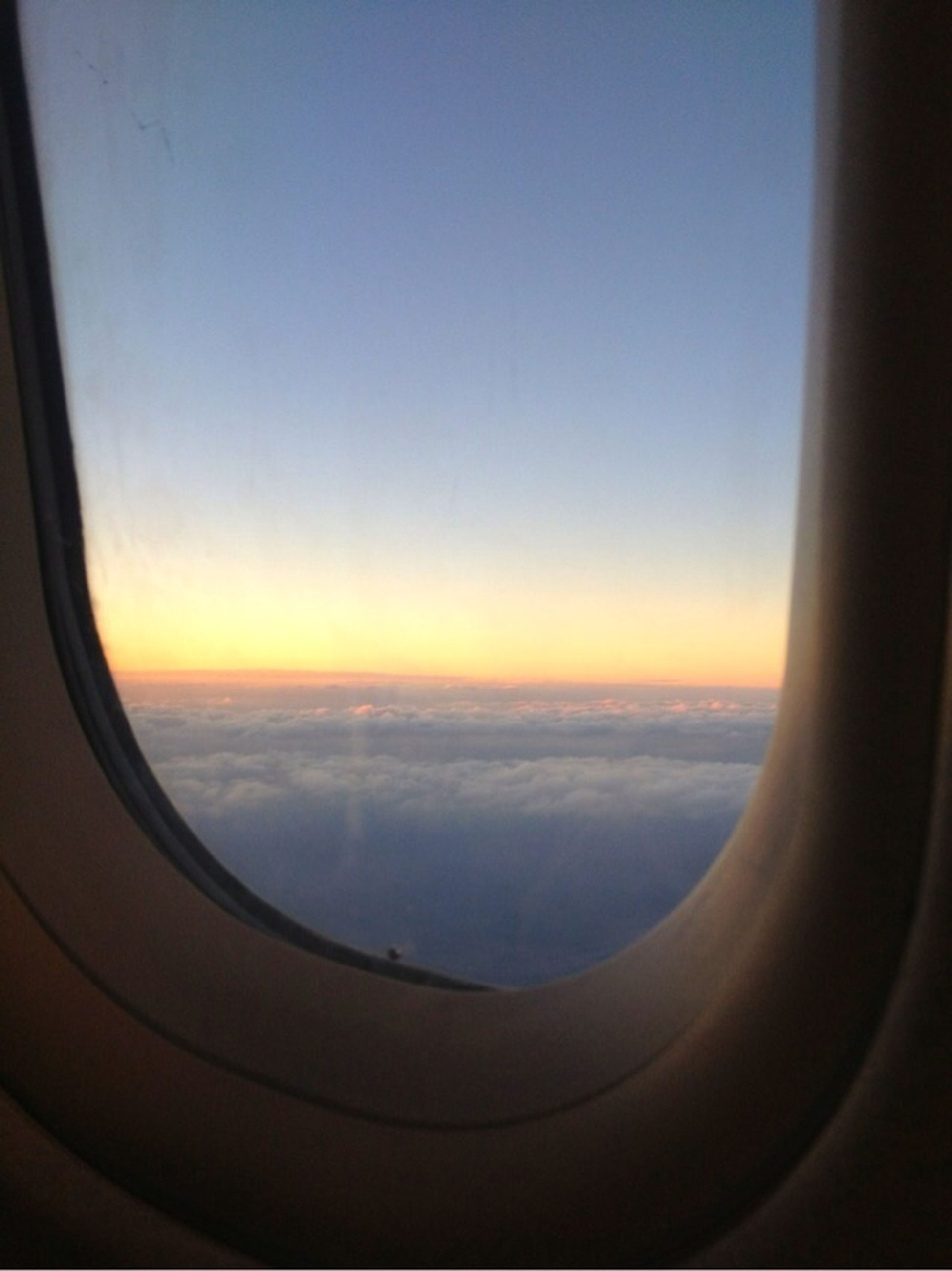 airplane, air vehicle, transportation, window, flying, mode of transport, aircraft wing, scenics, sky, vehicle interior, sunset, aerial view, beauty in nature, sea, travel, transparent, part of, journey, mid-air, glass - material