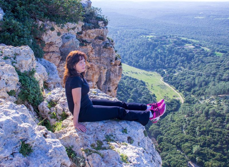 woman in a black tracksuit sitting on the cliff and looking into the distance Black Cliff Costume,party,animal Print Dark Ebony Escapism Femininity Geology Petticoat Physical Geography Rock Rock - Object Rock Formation Sable Seated Sitting, Seated Sport Sport Suit, Sport, Suit, Costume, Suit, Costume, Tracksuit  Woman Womanhood Womankind Women Women, Womankind, Womanhood, Womenfolk