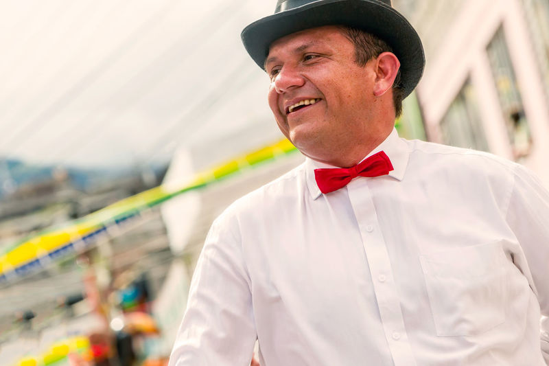 Bow Tie City City Life Close-up Cultural Dance Day Focus On Foreground Happy Hat Lifestyles One Person Outdoors Party Politics Portrait Real People Red Red Tie Smile Smiling Social Street Tie Urban