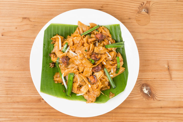 Plateful of delicious and popular Penang Char Kuey Teow, popular food in Malaysia Char Kuey Tiaw Malaysian Food Close-up Food Food And Drink Freshness Healthy Eating High Angle View Indoors  No People Penang Malaysia Plate Ready-to-eat Serving Size Still Life Table Wellbeing