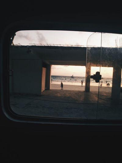 Silhouette person seen through window