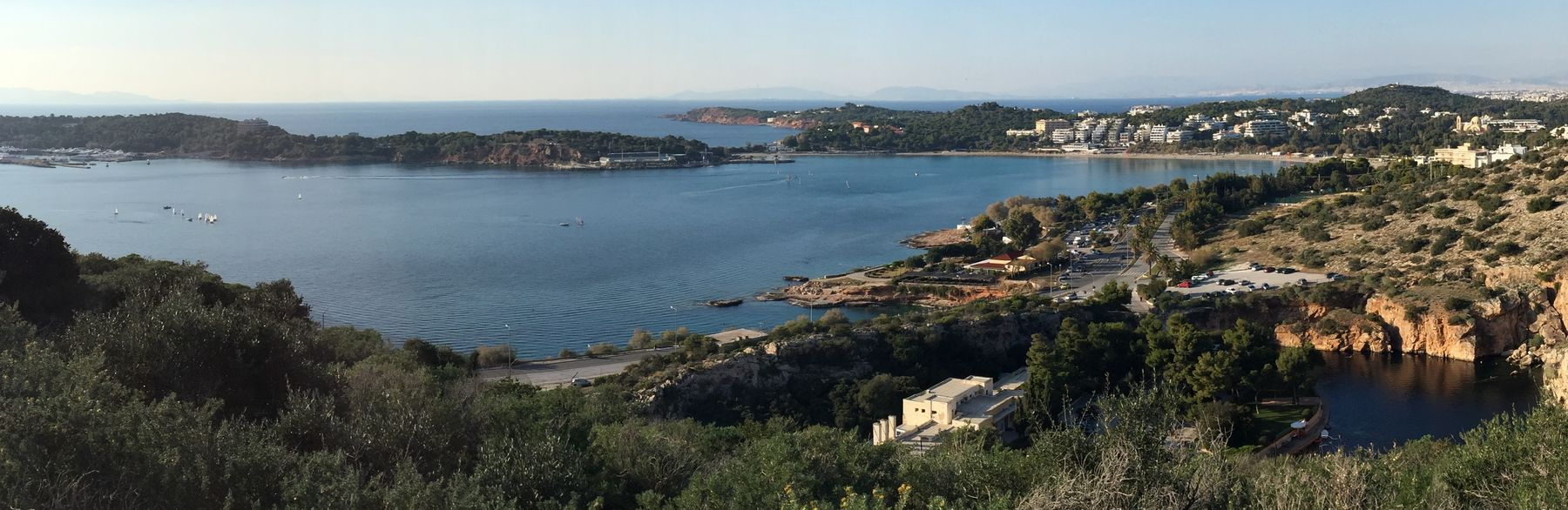 ESE view at Faskomilia, looking the lake, the beach and the peninsula of Vouliagmeni.
