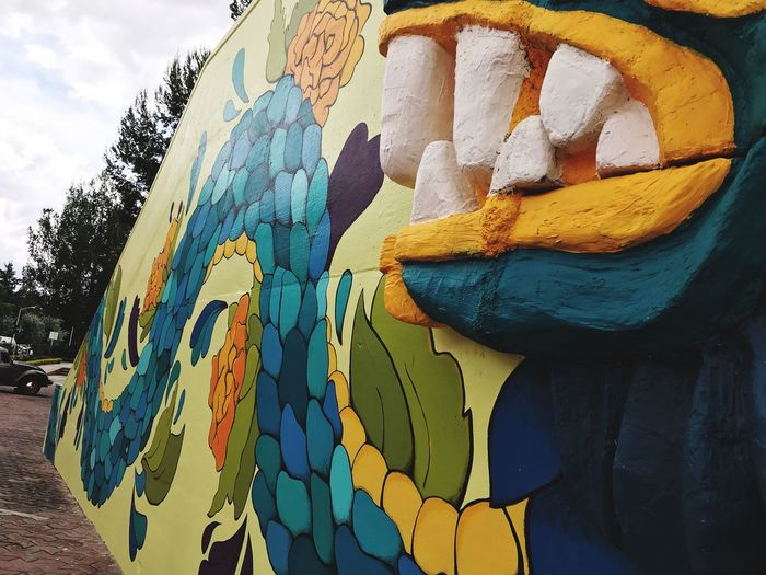 Quetzalcóatl Day Multi Colored No People Art And Craft Nature Creativity Outdoors Close-up Wall - Building Feature Pattern Sky Built Structure Low Angle View Textured  Architecture Design