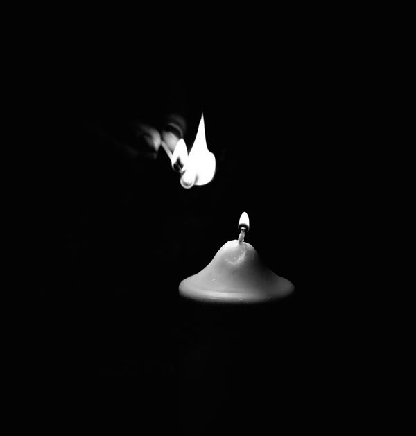 Light up the Candles, it's Friday :) Black & White Black And White Black Background Blackandwhite Burning Candle Close-up Diya - Oil Lamp Flame Heat - Temperature Illuminated Indoors  No People HUAWEI Photo Award: After Dark