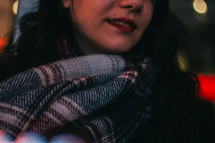 Midsection Of Woman Wearing Scarf At Night During Winter