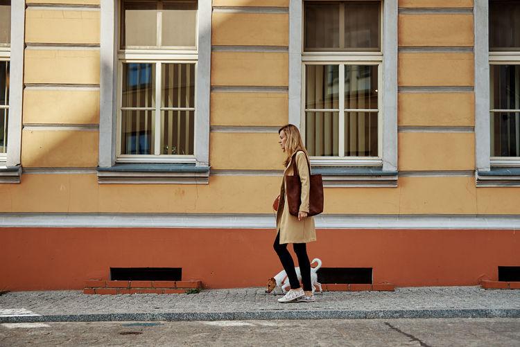 Woman walks with dog