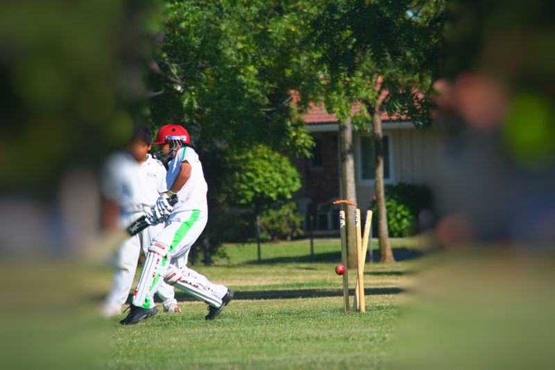 Side View Outdoors Full Length Playing Mid-air Motion Elementary Age Grass Flying On The Move Focus On Foreground Enjoyment Hobbies Park - Man Made Space Cricket Cricket Pitch Cricket Ball Cricket Field Cricket Match Cricket Lover Cricket Fever Is ONN The Color Of Sport Cricket Bat Cricket Stumps Bowled EyeEm Selects