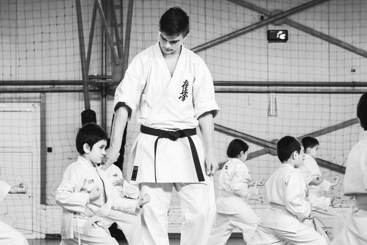 New Year's Resolutin: Train Harder! Balance Black And White Concentration Concentrationcamp Equilibrium EyeEm Best Shots Instructor Karate Martial Arts Martial Arts Children Mentor New Years Resolutions 2016 Photooftheday Showcase: December Sitting The Week Of Eyeem Train Hard Training Work Hard Play Hard Working Hard Youth Of Today Telling Stories Differently Finding New Frontiers