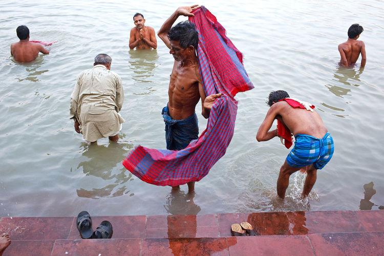A morning bath in Hooghly River near Howrah Bridge in Kolkata, India. People Travel India Street Photography Kolkata River Hooghly Bath Bathing The Street Photographer - 2017 EyeEm Awards