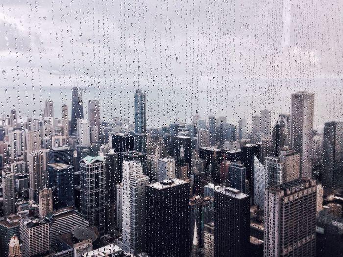 Cityscape Seen Through Wet Glass Window