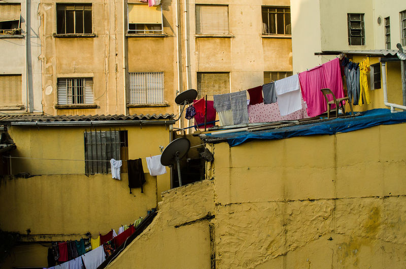 Architecture Building Exterior Built Structure Casual Clothing Chores Clothesline Clothing Day Drying Full Length Hanging Laundry Washing Window