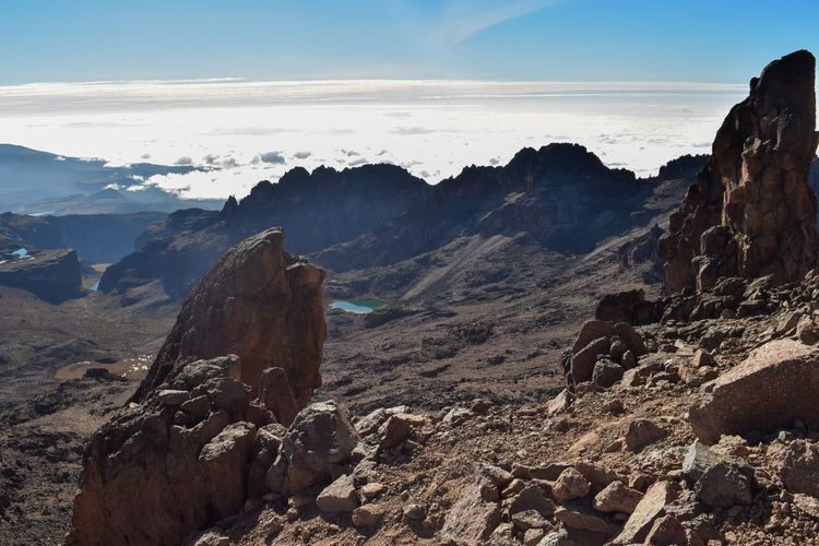 Volcanic rock formations above the clouds at mount kenya, kenya