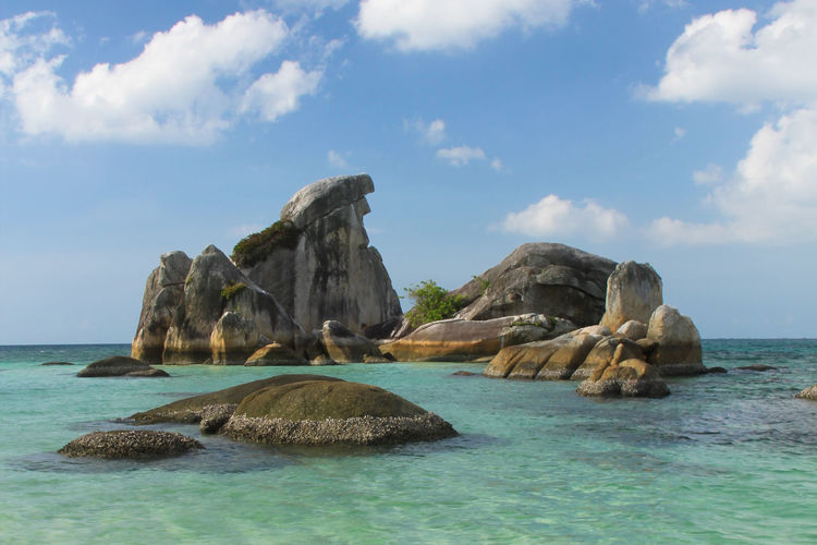 Beautiful granite rock formation in Belitung Island Granite Rocks Tropical Paradise Beauty In Nature Cloud - Sky Day Eroded Horizon Horizon Over Water Idyllic Island Marine Nature No People Outdoors Rock Rock - Object Rock Formation Sea Sky Solid Stack Rock Tranquil Scene Turquoise Colored Water Waterfront