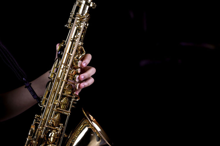 Music Instrument Alto Saxophone Player, Saxophone Player Isolated on black Music Musical Instrument Arts Culture And Entertainment Playing Musician Performance Artist Human Hand Saxophone Hand One Person Human Body Part Musical Equipment Holding Skill  Real People Indoors  Metal Wind Instrument Black Background Finger