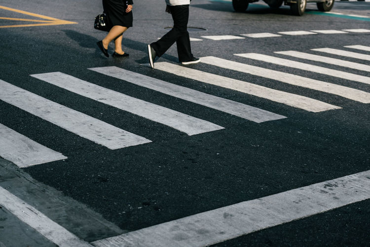 business with crosswalk Business Body Part Business Walk City City Life Crossing Crosswalk Day Human Body Part Human Foot Human Leg Human Limb Low Section Marking Move Outdoors Real People Road Road Marking Sign Street Transportation Walking Women Zebra Crossing
