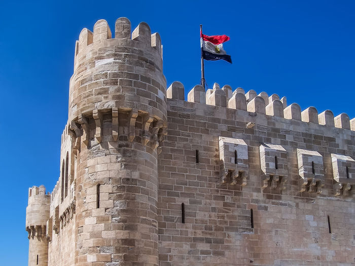 Citadel Alexandria Egypt Architecture Building Exterior Built Structure Castle Citadel Day Egypt Flag History Low Angle View No People Outdoors Patriotism Sky Travel Destinations