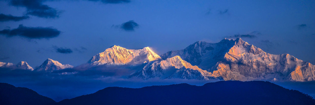 KANCHENJUNGA, INDIA. Sunrise over Kanchenjunga seen from Darjeeling Mountain Mountain Range Scenics - Nature Cloud - Sky Beauty In Nature Panoramic No People Mountain Peak Blue Environment Landscape Travel Destinations Tranquility Geology Outdoors Sky India Kanchenjunga Ice Snowcapped Mountain Himalayas Glaciers Nature Tranquil Scene