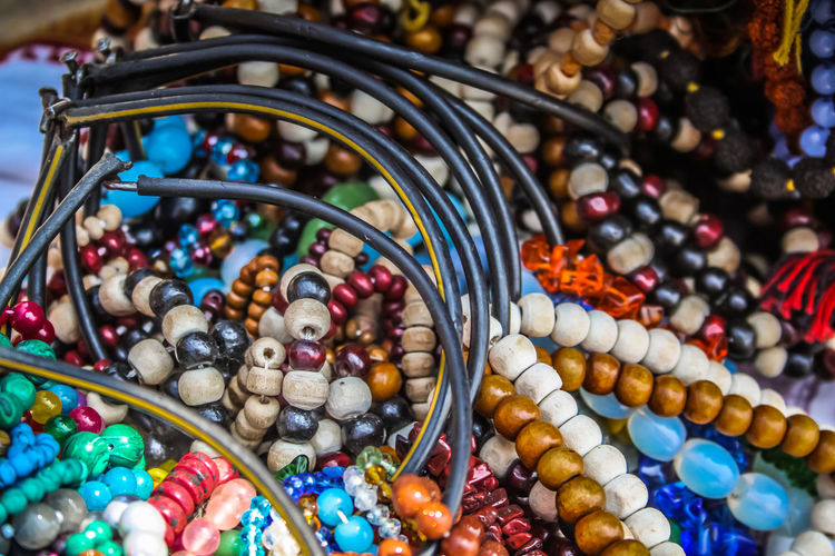 Close-up of multi colored jewelry for sale in market