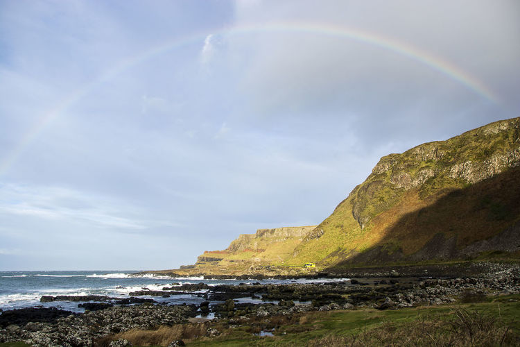 Magic rainbow on the cliff Rainbow Beauty In Nature Sky Water Scenics - Nature Sea Cloud - Sky Tranquility Land Tranquil Scene Nature Beach Day Idyllic Non-urban Scene No People Horizon Rock - Object Horizon Over Water Outdoors Double Rainbow