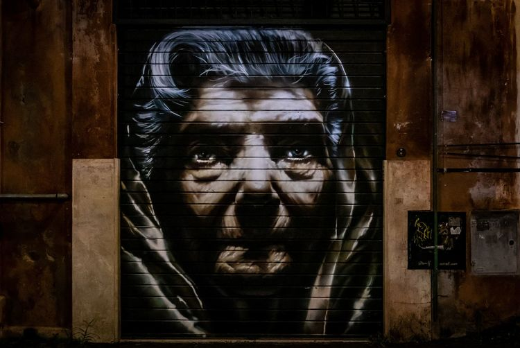 Mural of old woman on building