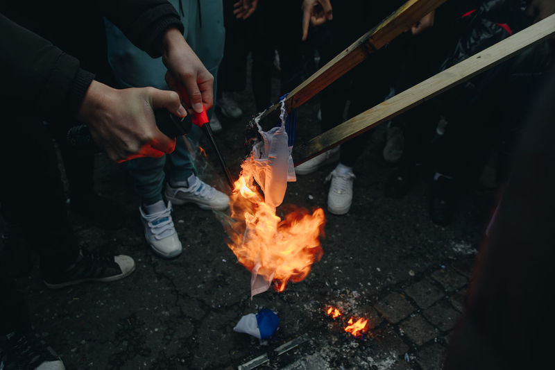 Low section of people holding fire