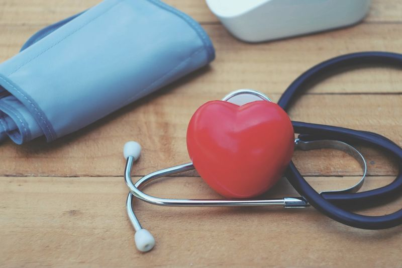 Red heart, stethoscope and blood pressure monitor on wood table Pressure Pulse Cardiology Cardiac Hospital Help Emergency Accident Illness Healthy Healthcare Sick Care Insurance Weakness Physiotherapy Diagnostic Disease Wellness Medical Health Cure Injury Patient Clinical