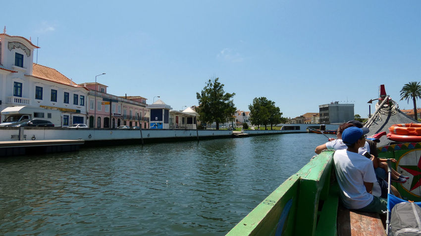 Ria de Aveiro. Houses Natural Beauty Nature Nature Photography Architecture Building Exterior Built Structure City Day Group Of People Incidental People Lifestyles Men Mode Of Transportation Nature Nature_collection Naturelovers Nautical Vessel Outdoors Real People River Sky Transportation Water Women
