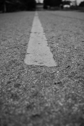 Close-up of arrow symbol on road