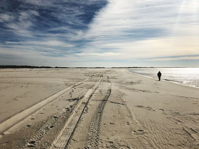 Beach Sand Sky Cloud - Sky Real People Shore One Person Nature Sea Walking Scenics Standing Tranquil Scene Beauty In Nature Full Length Day Tire Track Outdoors Tranquility Lifestyles
