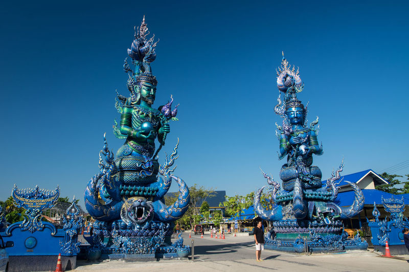 Blue Temple in Chiang Rai Art And Craft Representation Sky Architecture Creativity Sculpture Blue Built Structure Clear Sky Nature Statue Human Representation Building Exterior Day No People Outdoors City Craft Dragon Ornate Festival